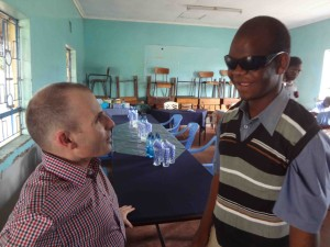 Alan Foley and KU Student Mandela talking at Kibos School